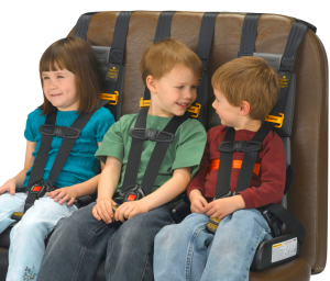 Three children on one seat are buckled into the their SafeGuard STAR portable restraints.
