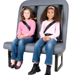 Two students are buckled up on the SafeGuard BTI seat.